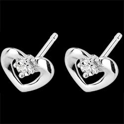 <a href=http://en.edenly.com/jewels/white-gold-and-diamond-enchanted-heart-earrings,1608.html>White Gold and Diamond Enchanted Heart Earrings <br><span>� 169</span></a>